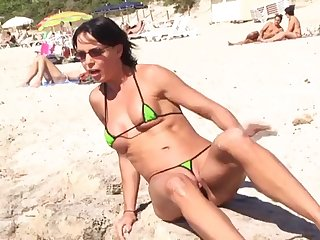 hot brunette milf in micro bikini posing on public beach 3